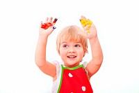 Little girl with paint on her hands isolated on white background