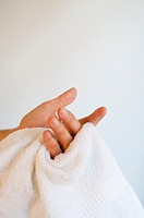 Man drying his hands with the towels. Close view.