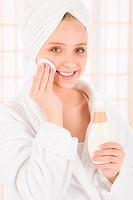 Acne facial care teenager woman clean skin in bathroom