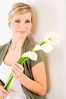 Portrait of romantic woman hold calla lily flower on white