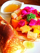 pancake with tropical fruits and honey