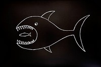 The big fish eats the small one. Conceptual image made with chalk on a blackboard.