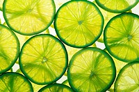 Green lime slices in many layers on white background