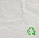 A recycled paper background with green sign