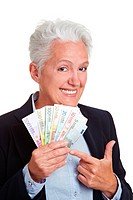 Happy senior woman holding Euro money fan