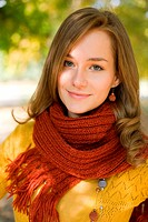Outdoors portrait of beautiful colorful fall fashion woman.