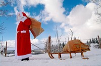Santa Claus, Father Christmas in a beautiful winter landscape