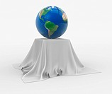 Earth globe sitting on a table cloth. 3d render illustration