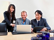 Group of diverse colleagues working on laptop
