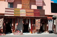Moroccan building with newly produced Berber carpets in the Medina of Marrakech