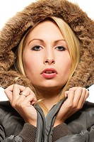 beautiful blonde woman wearing a parka with fur on white background