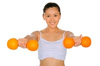 asian woman engaged in fitness dumbbells of oranges isolated on white
