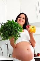 pregnant woman on kitchen