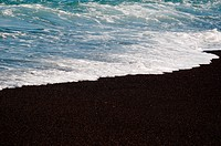 Black volcanic sand on El Golfo bay on Lanzarote, Canary Islands, Spain