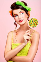 portrait of beautiful girl with big lollipop