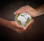 Hands protecting a glowing planet globe against a white background