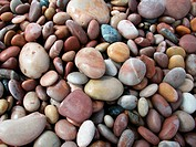 Full frame pebble beach background, relaxing and tranquil