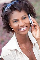 Beautiful Happy African American woman talking in her cell phone