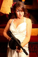 Beautiful woman with sub machine gun.