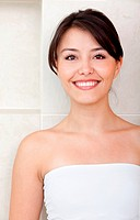 Beauty portrait of a pensive female smiling at a bathroom