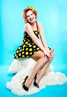 portrait of girl dressed and maked up in retro style posing on white fur