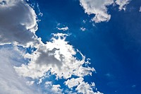 White cloud in blue sky with sun light for background