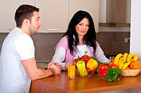 Couple in kitchen thinking and having conversation about what to cook in their kitchen