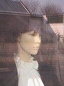 Detail of a female mannequin in a store window
