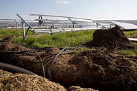 Installation of pipes and solar panels in a field