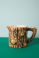 A ceramic creamer made to look like tree bark