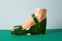 A retro female mannequin's foot wearing a sandal (thumbnail)