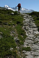 A hiker on a footpath, Valais Canton, Switzerland