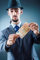 Detective looking at fake money