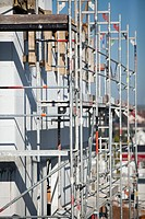 A tilt_shift shot of scaffolding on a building under construction