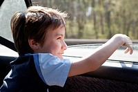 A child looking out a car window