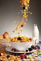Cereal and fruit being poured into a bowl (thumbnail)