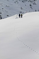 Two people in distance on snow hike