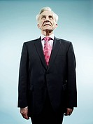 An elegant senior man wearing a suit and pink paisley tie (thumbnail)