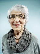 An elegant senior woman smiling at the camera (thumbnail)
