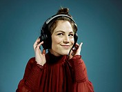 A young hip woman wearing headphones and smiling (thumbnail)