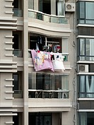 Laundry hanging from a balcony, Xiamen, China