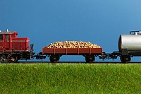 A miniature toy freight train