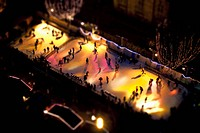 Tilt_shift of skaters on an ice rink at night, Strasbourg, France