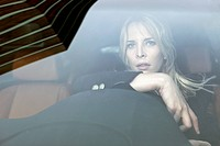 Pensive woman driving (thumbnail)