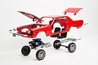 A model car taking a part, some pieces in mid_air