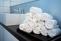 Rolled towels stacked in the shape of a pyramid
