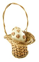 Easter egg in a wattled basket isolated on a white background/part of Easter series