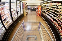 A shopping cart on an aisle in a supermarket, personal perspective (thumbnail)