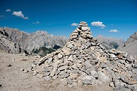 A large pile of rocks forming a cairn in the Wetterstein Mountains, Austria