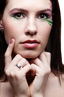 portrait of beautiful brunette with eye_zone body art and violet fingernails
